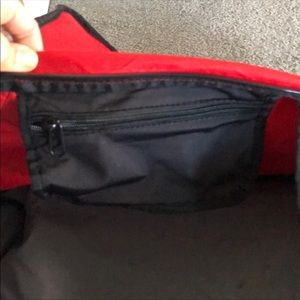 Nike Bags - NWT LARGE DUFFLE BAG. RED AND BLACK.